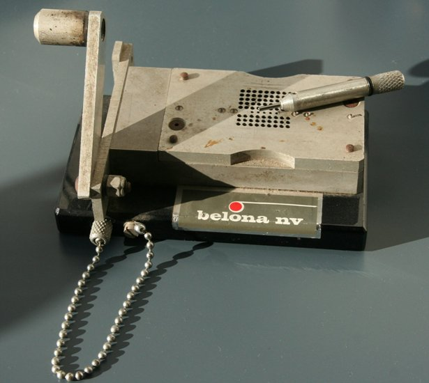 Punchtape repair tool: cutter and hole puncher