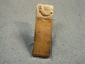 One of the two wooden strips with dental imprint