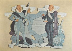 Relief designed by prof.dr. O. Wenckenbach depicting Prince Maurits and Simon Stevin. In the background pentagonal bastions, a sailing wagon, 'Wisconstighe Ghedachtenissen' (mathematical deliberations), hydraulic engineering (mill), the balance law for levers and the 'clootcrans'. The relief is loacted in the main lobby of the Prince Maurits Lab building at the Lange Kleiweg, Rijswijk.