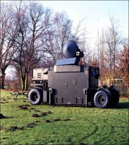 The Flycatcher developed by HSA is in service from 1979 to 2005. The Flycatcher consists of a radar and a fire control system, housed in a control shelter that accommodates two people. The cone on top of the radar is the target tracking antenna. The large bar below is the scanning antenna. Photo and text NIMH-Imagebank Defense; text: RNLAF team IJmuiden